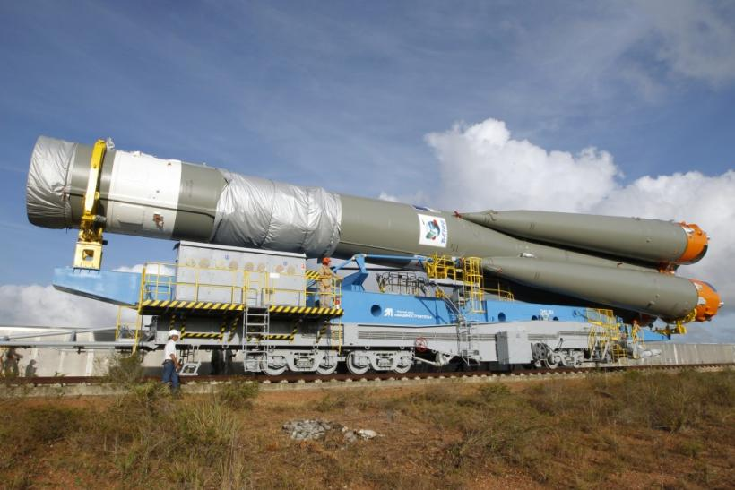 A technicians walks near the Soyuz VS01 rocket as it is transported to its launch pad at the Guiana Space Center in Sinnamary, French Guiana