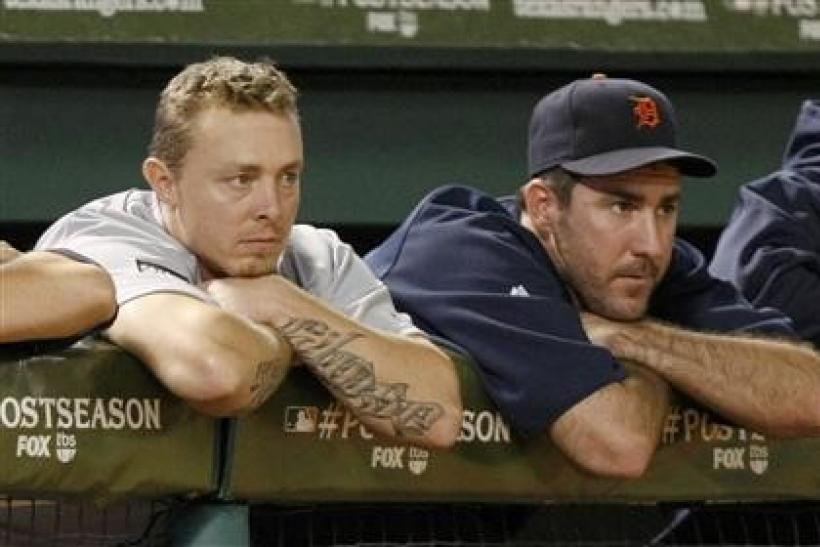 Detroit Tigers third baseman Brandon Inge (L) and pitcher Justin Verlander watch the action against the Texas Rangers during the eighth inning of Game 6 of MLB's ALCS baseball playoffs in Arlington, Texas