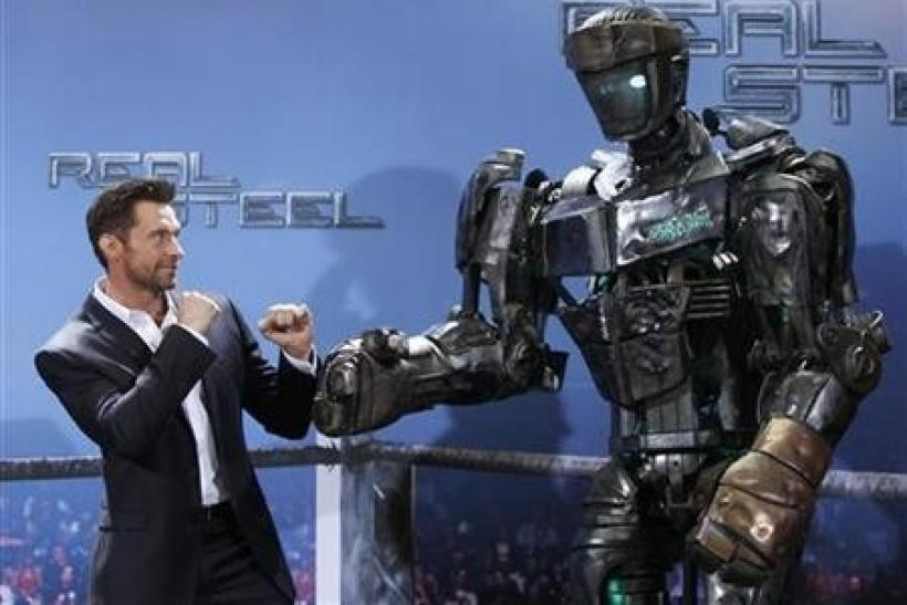 Australian actor Hugh Jackman poses during a photocall in Munich September 12, 2011 to promote the film ''Real Steel''. The movie will premiere in Germany