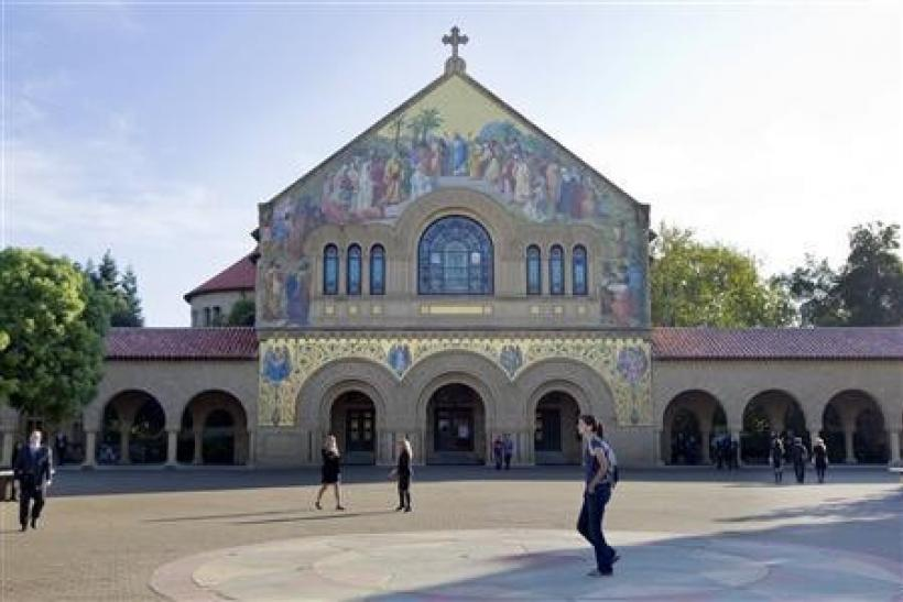 People walk in front of a church on the campus of Stanford University in Palo Alto, California