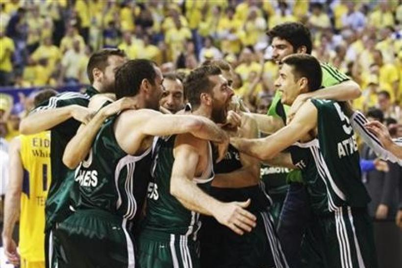Panathinaikos' players celebrate after defeating Maccabi Tel Aviv at the end of their Euroleague Final Four final basketball game at the Palau Sant Jordi in Barcelona