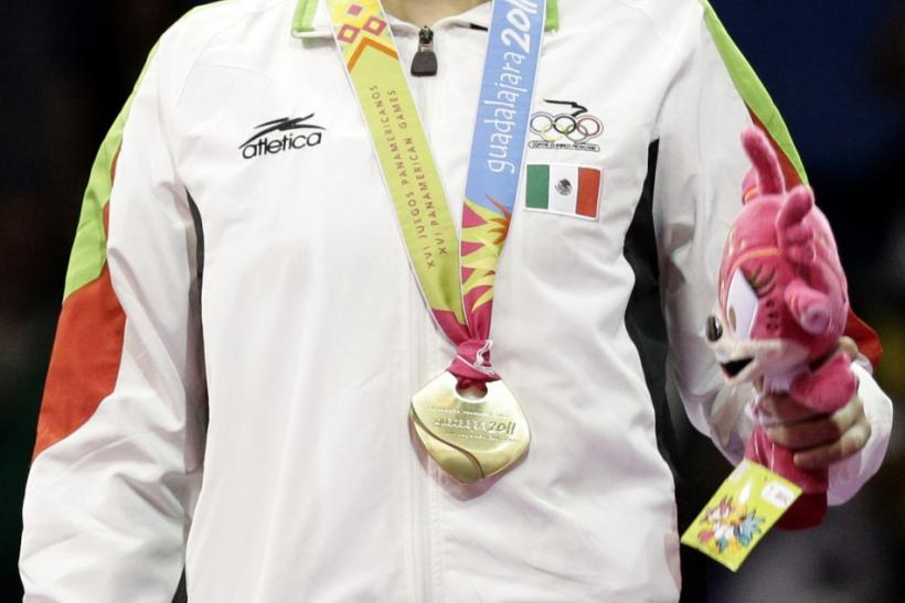 Gold medalist Irma Edith Contreras of Mexico reacts during the medal ceremony after the women's under 57kg final Taekwondo competition at the Pan American Games in Guadalajara