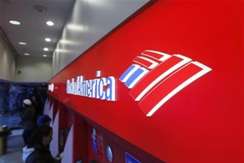 Customers use ATM machines inside of a Bank of America branch in Times Square in New York