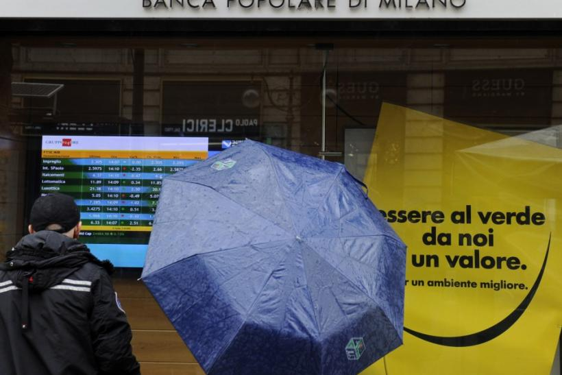 People stand in front of Banca Popolare in Milan