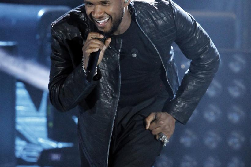 "Singer Usher performs during ""A Decade of Difference: A Concert Celebrating 10 Years of the William J. Clinton Foundation"" at the Hollywood Bowl in Hollywood, California"