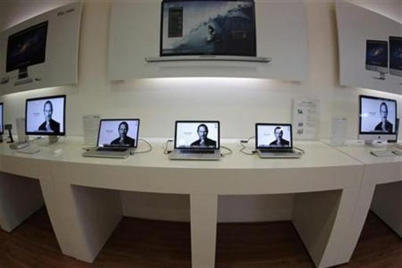 Apple computers display pictures of Steve Jobs on screen in the iShop in Guatemala City