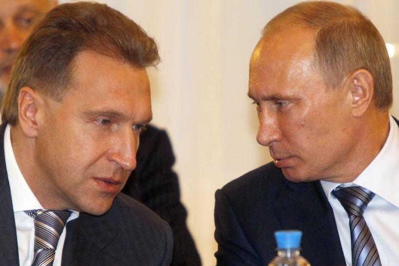 Russia's Prime Minister Putin speaks to First Deputy Prime Minister Shuvalov during a meeting with government leaders from Eurasian Economic Community countries in St.Petersburg