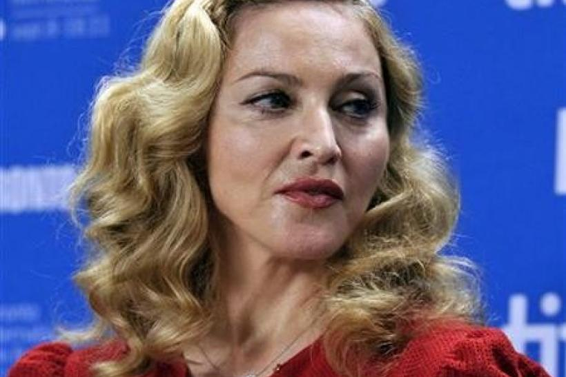 Director Madonna poses before the news conference for the film ''W.E.'' at the 36th Toronto International Film Festival