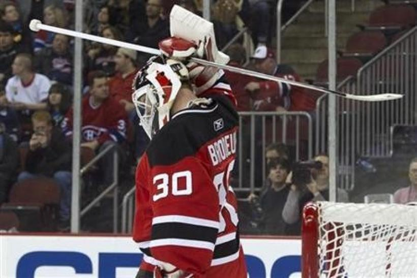 New Jersey Devils goalie Martin Brodeur holds his head during a pause in the third period of their 3-1 loss to the Montreal Canadiens in their NHL hockey game in Newark, New Jersey