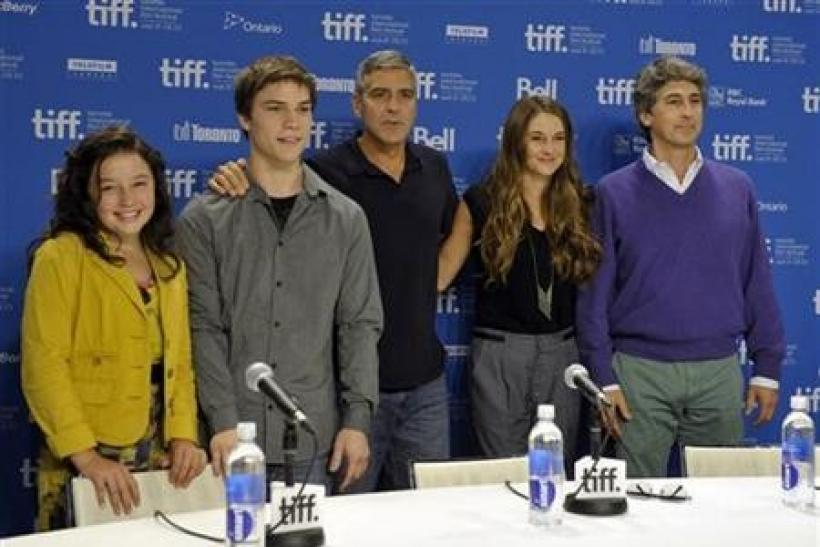 Cast members (L to R) Amara Miller, Nick Krause, George Clooney, Shailene Woodley and director Alexandrer Payne pose at the news conference for the film 'The Descendants' at the 36th Toronto International Film Festival