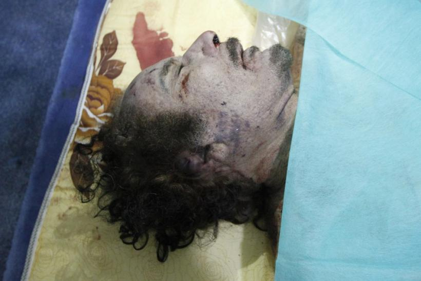 The body of former Libyan leader Muammar Gaddafi is displayed at a house in Misrata October 20, 2011.