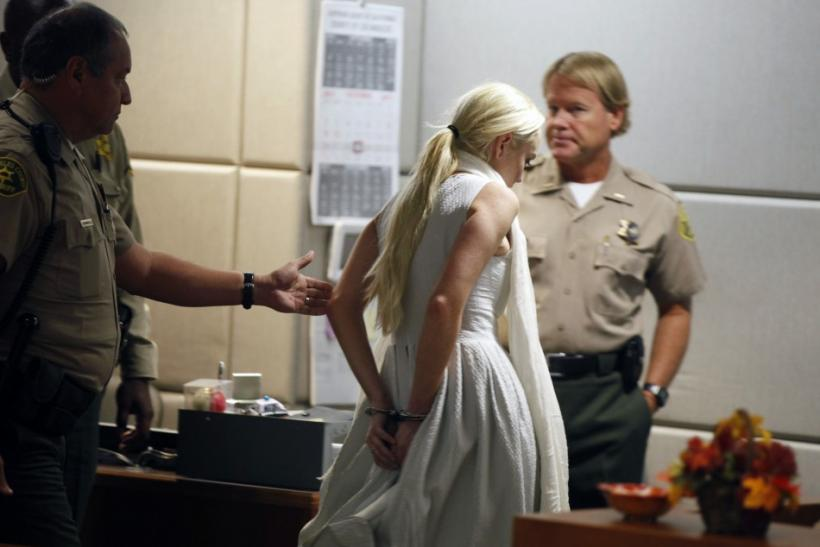 Lindsay Lohan is handcuffed after a judge revoked her probation for failing to appear at a series of community service appointments at the Downtown Women's Shelter at Airport Branch Courthouse in Los Angeles