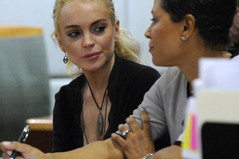Actress Lindsay Lohan and her attorney Shawn Chapman Holley attend a preliminary hearing at the Airport Branch Courthouse in Los Angeles