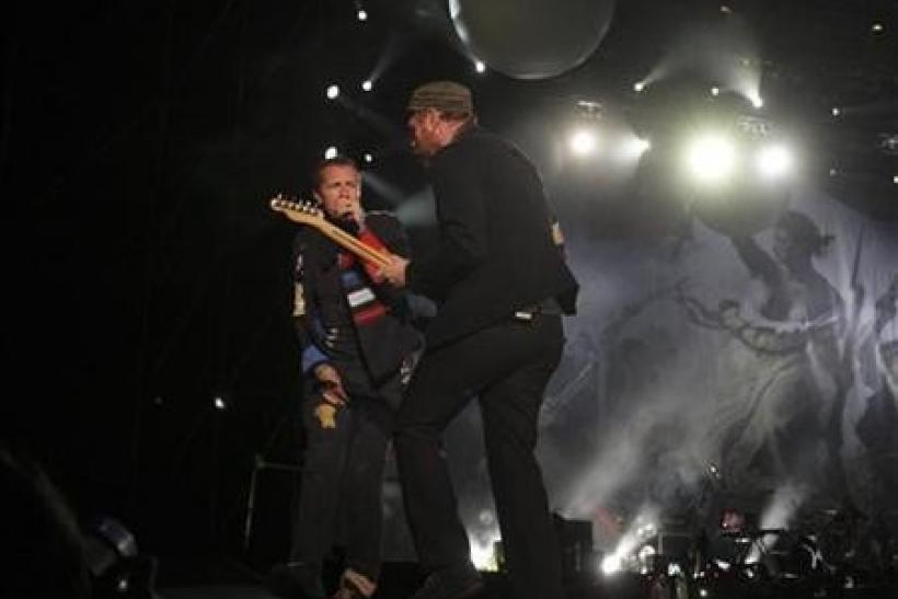 Guitarist Jonny Buckland (R) and singer Chris Martin of Coldplay perform during a concert as part of their ''Viva La Vida'' tour in Bogota