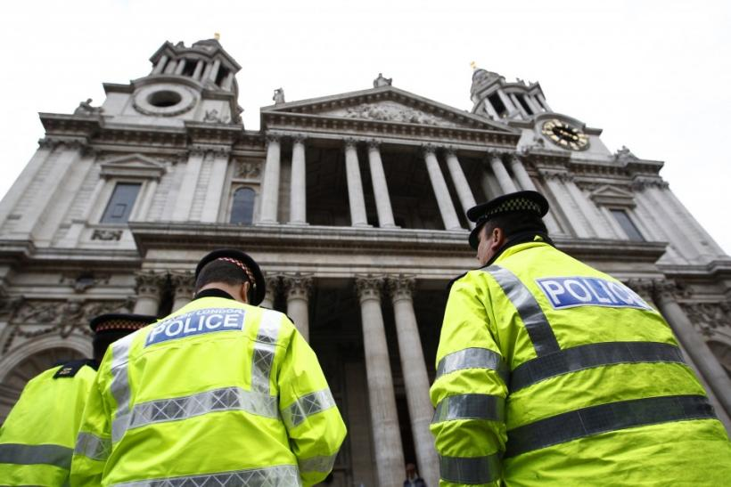 Police officers stand outside St Paul's Cathedral in central London