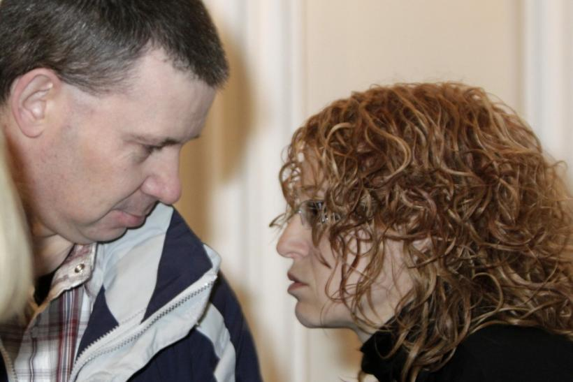 Irish citizen Michael Campbell listens to his lawyer Ingrida Botyriene during his trial in Vilnius