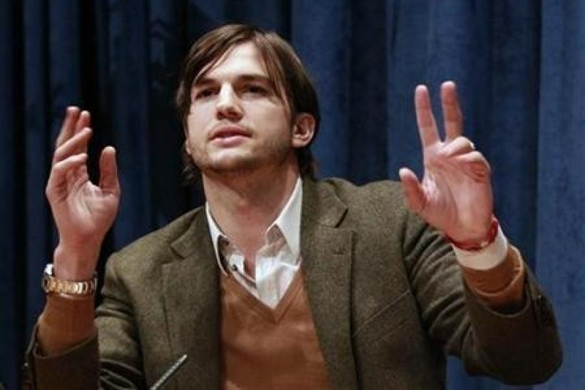 Actor Ashton Kutcher speaks during a news conference at the United Nations Headquarters in New York