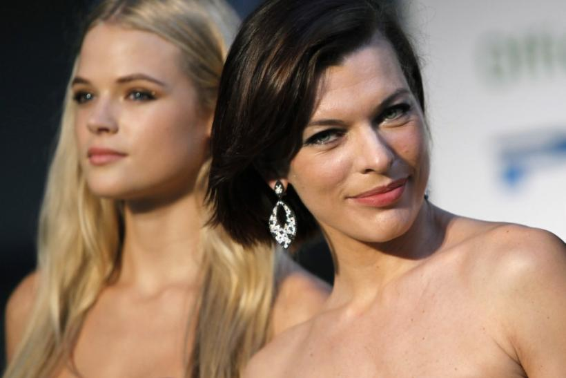Cast members Milla Jovovich (R) and Gabriella Wilde pose during a photo session at the Tokyo International Film Festival