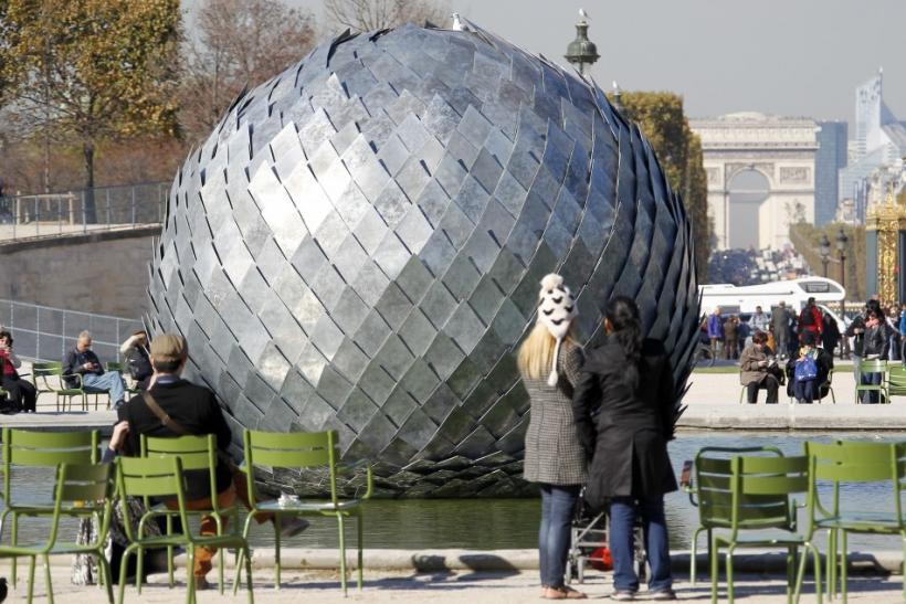 """The sculpture """"Una misteriosa bola, 2011"""" by French artist Antoine Dorotte is displayed in the Tuileries Garden in Paris"""