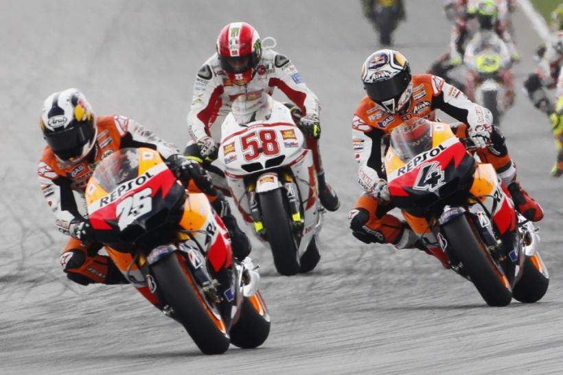 Honda MotoGP rider Marco Simoncelli of Italy takes the first corner on his second lap before he crashes at the Malaysian Motorcycle Grand Prix in Sepang