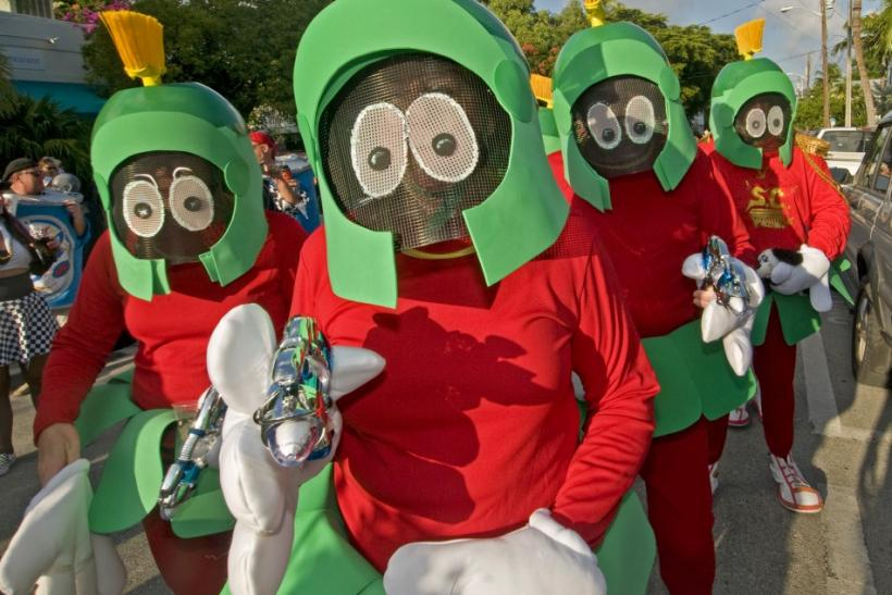 People dressed as Marvin the Martian stroll in the Fantasy Fest Masquerade March in Key West, Florida, October 29, 2010.