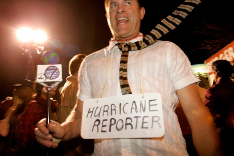 """Marcel Stinissen is in a costume as a hurricane reporter during """"West Hollywood Carnaval"""", a celebration of Halloween in West Hollywood, California October 31, 2005."""