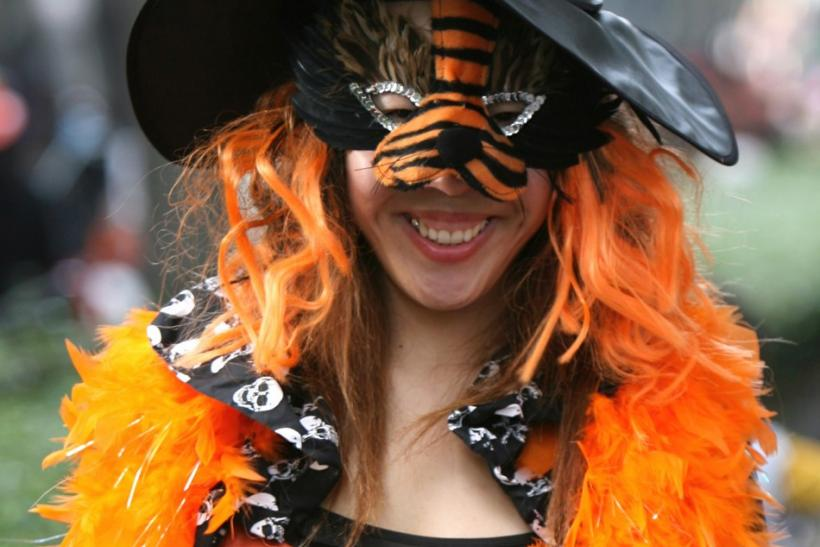 A woman dressed in a Halloween costume takes part in a parade in Tokyo's Harajuku Omotesando district October 29, 2006.