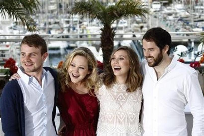 (L-R) Cast members Brady Corbet, Louisa Krause and Elisabeth Olsen pose with director Sean Durkin during a photocall for the film ''Martha Marcy May Marlene'' in competition for '' Un Certain Regard'' at the 64th Ca
