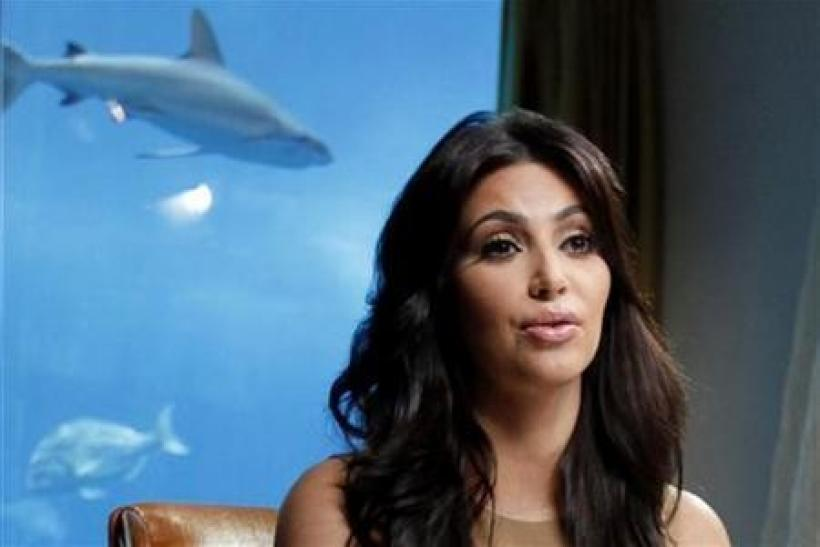 TV personality and actress Kim Kardashian speaks during an interview with Reuters in Dubai