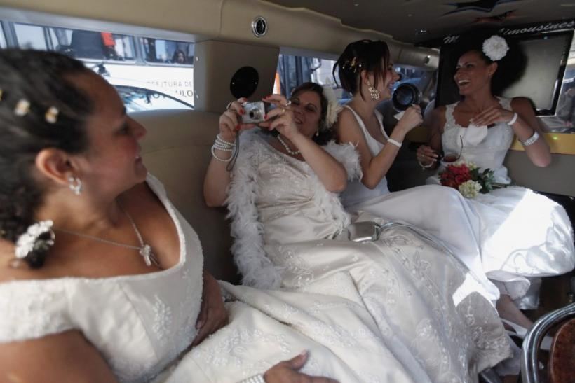 """Women in wedding gowns are made up backstage before the """"Parade of Brides"""" in Sao Paulo"""