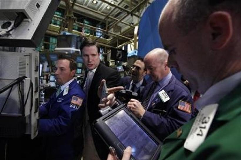 Traders work on the floor of the New York Stock Exchange October 21, 2011.