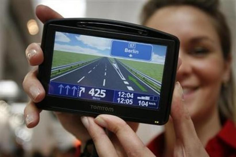 A model displays the new navigation device 'TOMTOM Go 930 T' during first public day at the CeBIT computer fair in the northern German town of Hanover