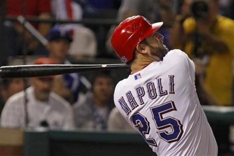 Texas Rangers' Mike Napoli hits a three run home run against the St. Louis Cardinals during the sixth inning in Game 4 of MLB's World Series baseball championship in Arlington, Texas