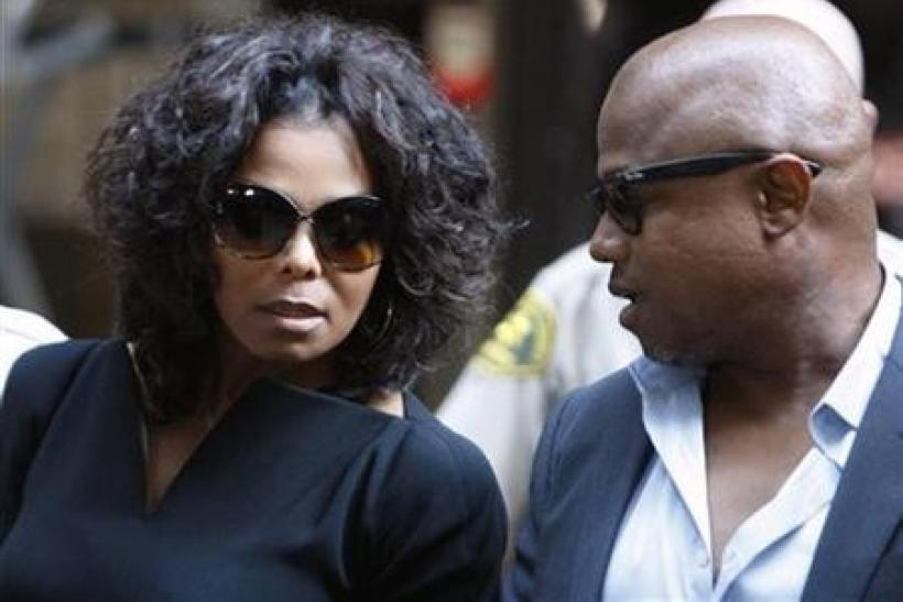 Janet (L) and Randy Jackson, siblings of deceased pop star Michael Jackson, leave court after the opening day of Dr. Conrad Murray's trial in the death of pop star Michael Jackson in Los Angeles