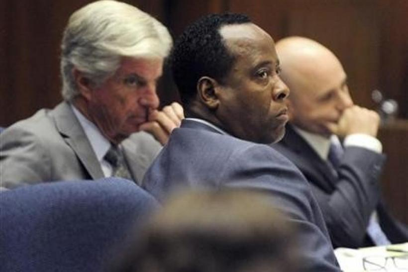 Dr. Conrad Murray (C) sits with his attorneys J. Michael Flanagan (L) and Nareg Gourjian (R) during Murray's involuntary manslaughter trial in the death of pop star Michael Jackson in Los Angeles