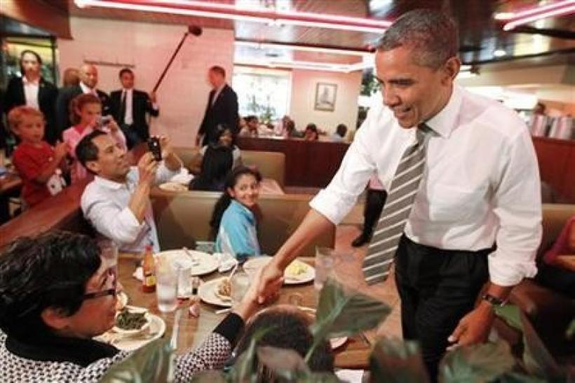President Barack Obama greets diners at Roscoe's House of Chicken and Waffles in Los Angeles