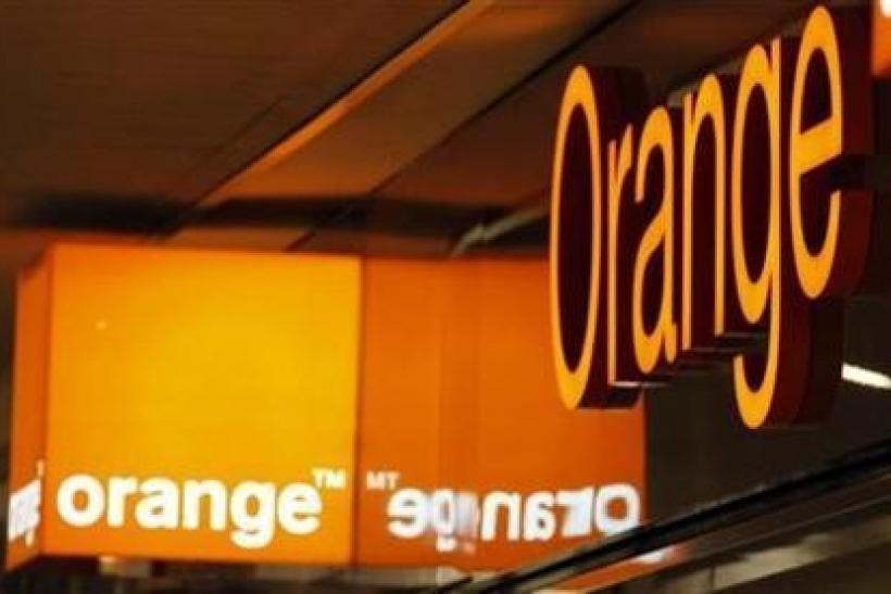 Logos of Orange are seen in front of an Orange France Telecom shop in Nice, southern France