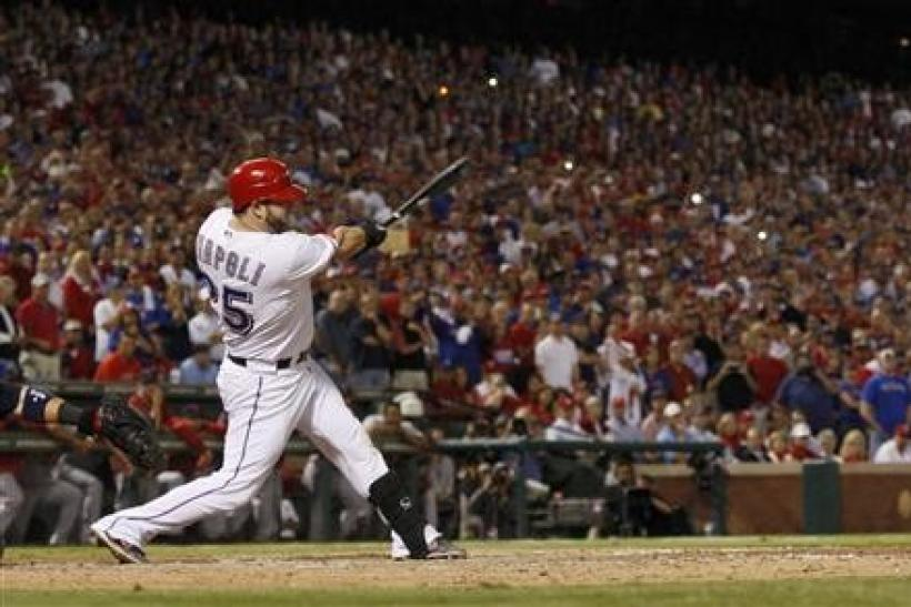 Texas Rangers' Mike Napoli hits a two-RBI double against the St. Louis Cardinals in the eighth inning of Game 5 of MLB's World Series baseball championship in Arlington, Texas
