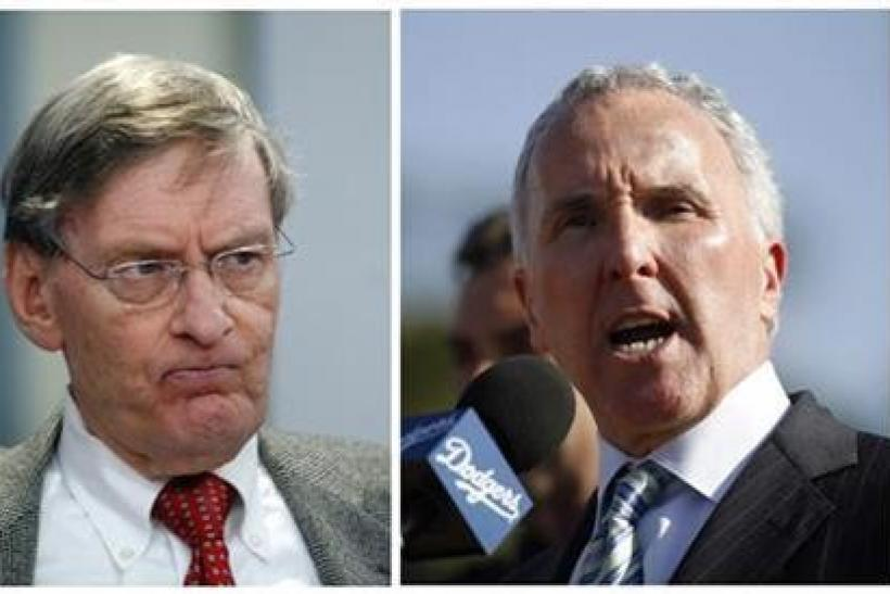 Major League Baseball commissioner Bud Selig (L) and Los Angeles Dodgers owner Frank McCourt are shown in this combination of file photos