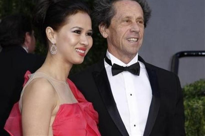 Producer Brian Grazer and wife Gigi Grazer arrive at the 2011 Vanity Fair Oscar party in West Hollywood, California