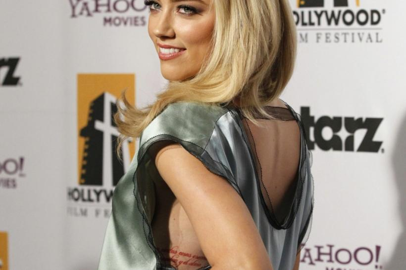 Actress Amber Heard poses at the 15th Annual Hollywood Awards Gala in Beverly Hills, California