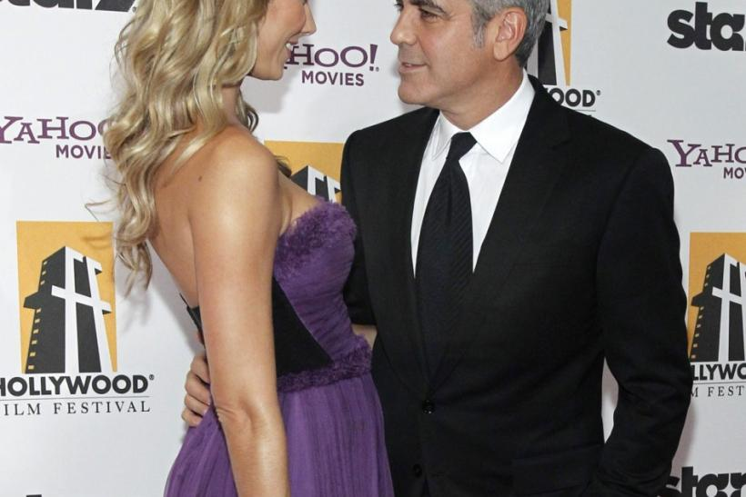 Actor George Clooney and Stacy Keibler pose at the 15th Annual Hollywood Awards Gala in Beverly Hills, California
