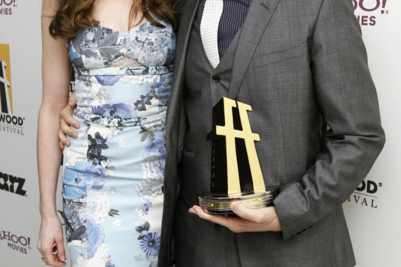 Actor Joseph Gordon-Levitt holds his Hollywood Breakthrough Actor Award as he poses with presenter Anne Hathaway backstage at the 15th Annual Hollywood Awards Gala in Beverly Hills, California