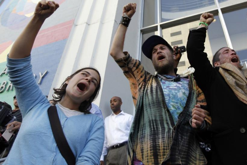 People yell out during an anti-Wall Street protest in Oakland