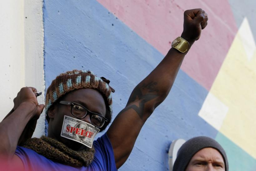 A man protests during an anti-Wall Street demonstration in Oakland, California