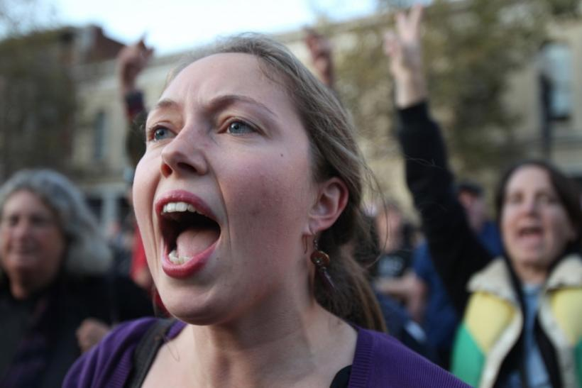 """An """"Occupy Wall Street"""" demonstrator chants during a demonstration in Oakland"""