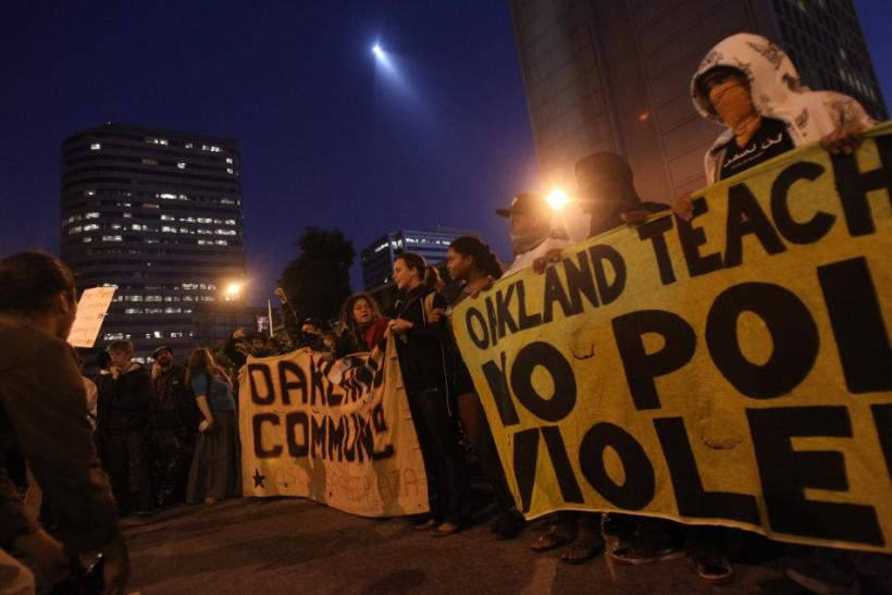 """A group of """"Occupy Wall Street"""" demonstrators chant in Oakland's financial district"""