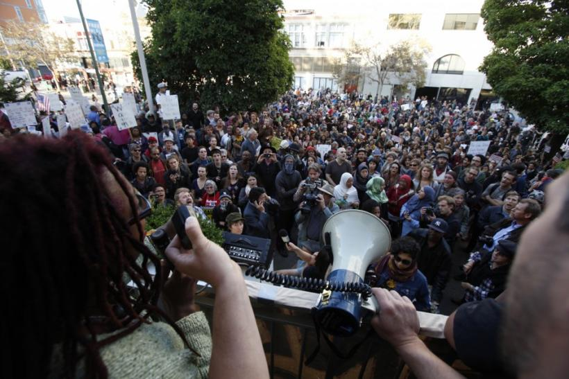 """Samsarah Morgan speaks to a group of """"Occupy Wall Street"""" demonstrators outside Oakland Public Library"""