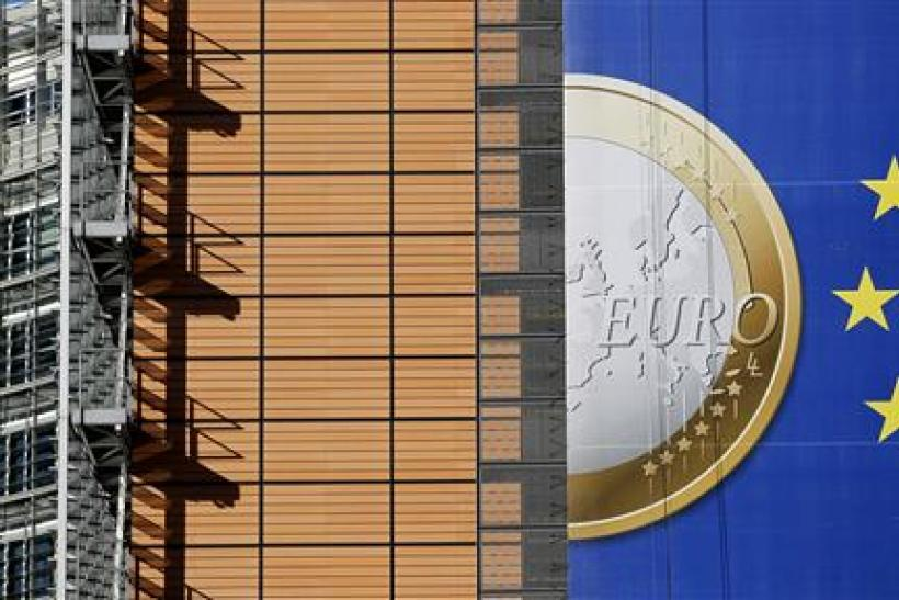 A banner showing a Euro coin is seen on the facade of the European Commission headquarters