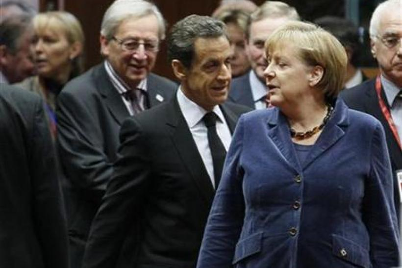 Luxembourg's Prime Minister Juncker France's President Sarkozy and Germany's Chancellor Merkel attend an European Union summit in Brussels
